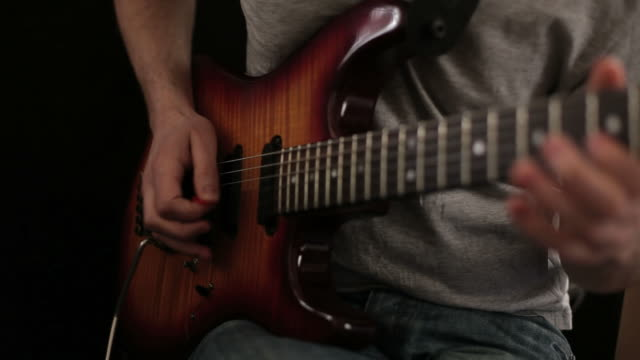 close up video of guitarists hands - plucking an instrument stock videos and b-roll footage