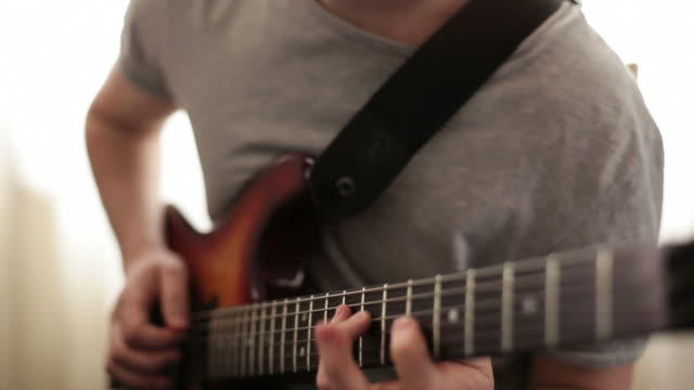 close up video of guitarists hands - musical instrument string stock videos and b-roll footage