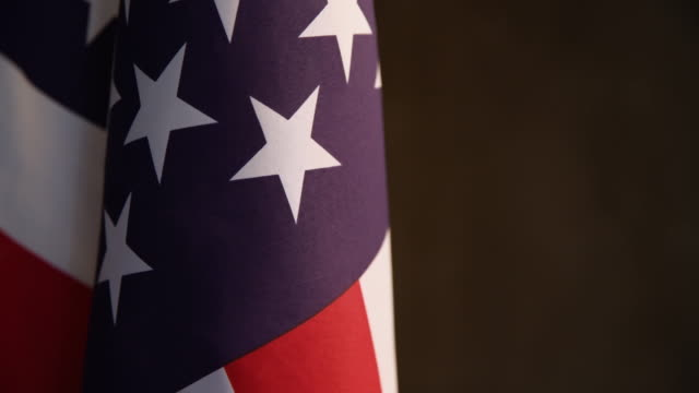 Close up video shoot of American flag on dark background