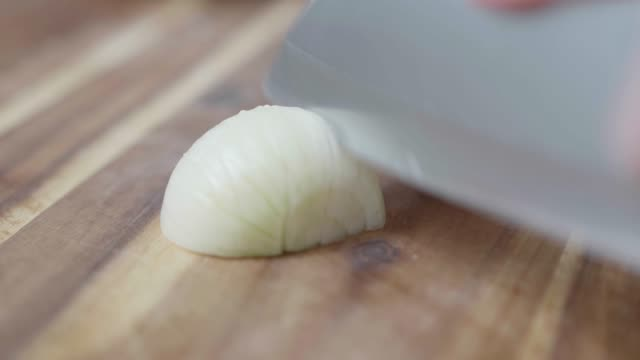 close up view fine chopping white onion - chopped food stock videos and b-roll footage