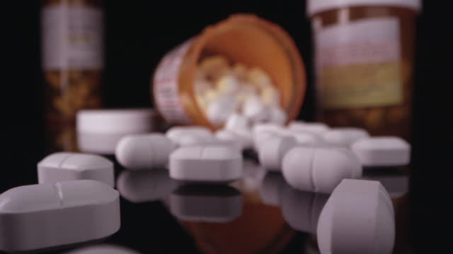 close up view moving over prescription drugs - pill addiction stock videos & royalty-free footage