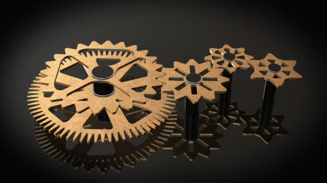 Close up view of animated rotating gold gears