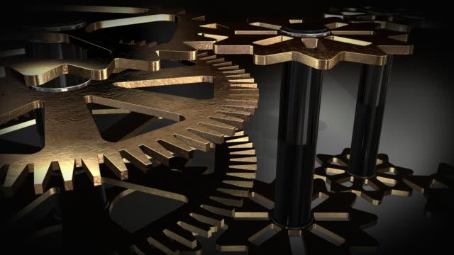 nahaufnahme blick auf die animierte rotierende goldenen getriebe - fünf gegenstände stock-videos und b-roll-filmmaterial