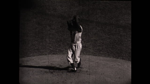 """close up view of baseball players on the field; crowd of people gathered around the stadium for the game; title card """"fourth game""""; tom sturdivant... - philadelphia phillies stock videos & royalty-free footage"""
