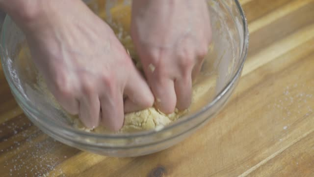 close up view of hand preparing shortbread dough