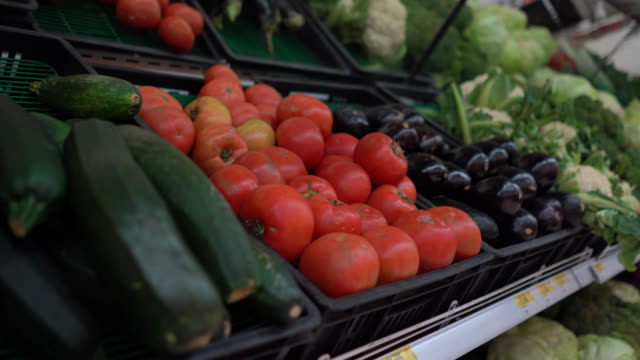close up view of vegetables in a refrigerated section at a supermarket - window display stock videos & royalty-free footage