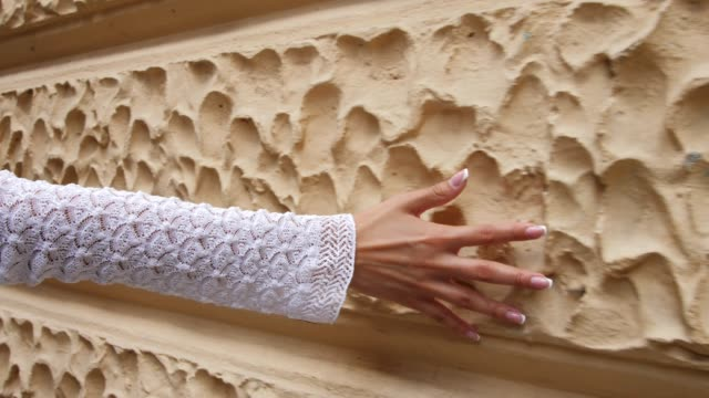 close up view of woman's hand touching stone wall - touching stock videos & royalty-free footage