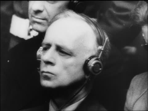 b/w 1945/46 close up von ribbentrop listening on headphones at war crime trials / nuremberg / documentary - processi di norimberga video stock e b–roll