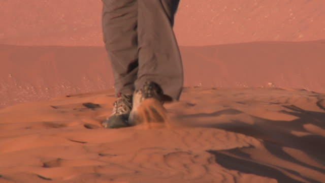 close up walking on sand, sossusvlei, namib-naukluft, namibia - boot stock videos & royalty-free footage