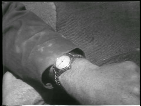 b/w 1952 close up watch on soldier's arm / yucca flats nevada / newsreel - anno 1952 video stock e b–roll