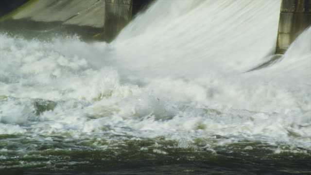 close up water spillway behind electricity generating dam - dam stock videos and b-roll footage