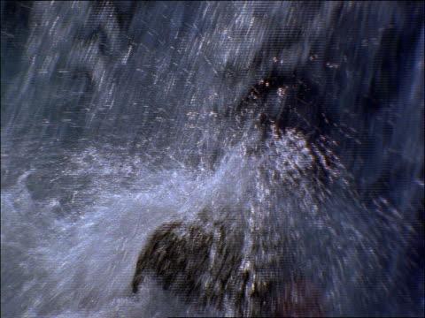 close up water splashing against rocks / Lake Tahoe, California