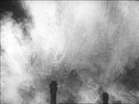close up wave crashing on debris from damaged hotel / long beach, california / newsreel - 1926年点の映像素材/bロール