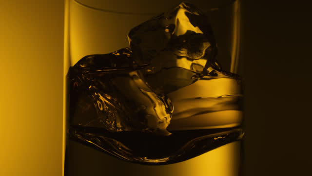 close up whiskey and ice spinning in glass - single object stock videos & royalty-free footage