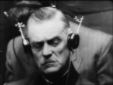 b/w 1945/46 close up wilhelm keitel listening on headphones at war crime trials / nuremberg / documentary - processi di norimberga video stock e b–roll