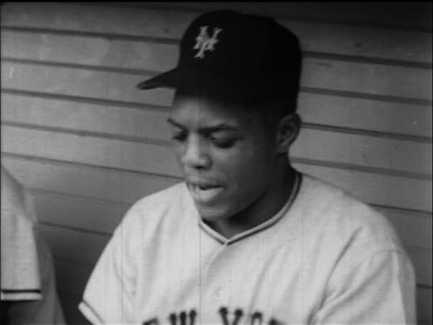 b/w 1954 close up willie mays looking down in dugout / looks to side in confusion / ny giants - 1954 stock videos and b-roll footage