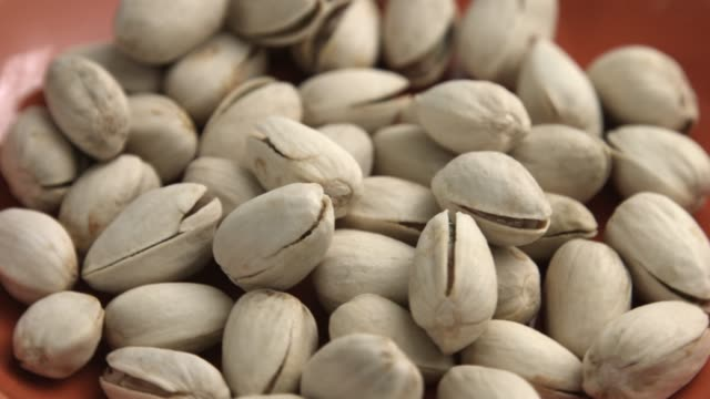 close up with pistachio rotating - nut food stock videos & royalty-free footage
