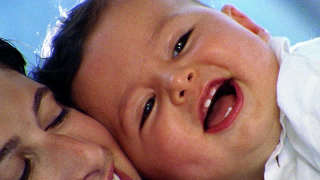 close up woman + baby cuddling / baby smiling with new teeth - 2000 stock videos and b-roll footage