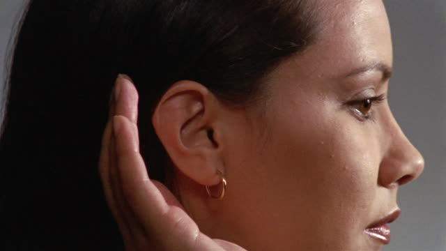 close up woman cupping ear - hoop earring stock videos and b-roll footage