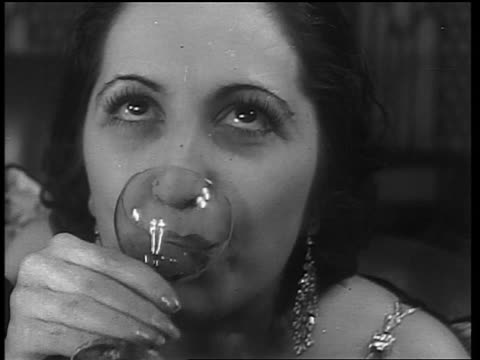 b/w 1933 close up woman drinking from small glass / end of prohibition - anno 1933 video stock e b–roll
