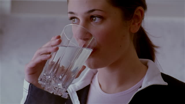 close up woman drinking water/ solebury, pennsylvania - drinking glass stock videos & royalty-free footage
