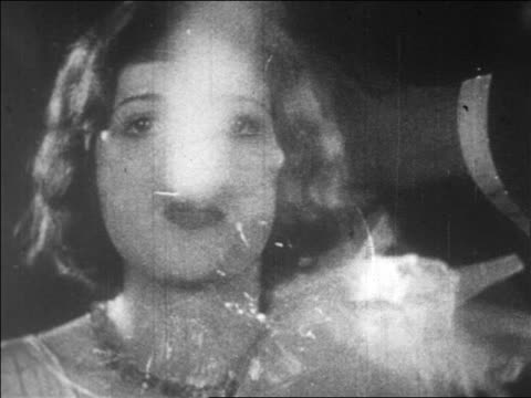 vídeos y material grabado en eventos de stock de b/w 1928 close up woman exhaling smoke / newsreel - fumar actividad