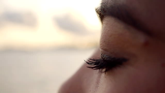 close up woman eyes slow motion - teardrop stock videos and b-roll footage