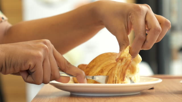 Close up woman hand with croissant