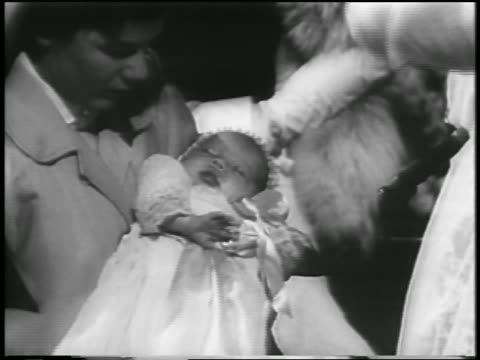 b/w 1957 close up woman holding baby princess caroline / newsreel - monaco royalty stock videos and b-roll footage