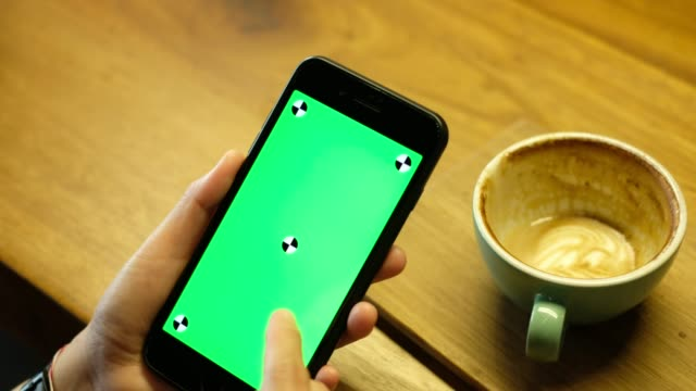 close up woman holding mobile phone with mark green screen slide screen on table in coffee shop - sliding stock videos & royalty-free footage