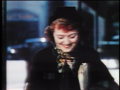1937 close up woman in hat smiling / hollywood ca / feature - solo una donna di età media video stock e b–roll