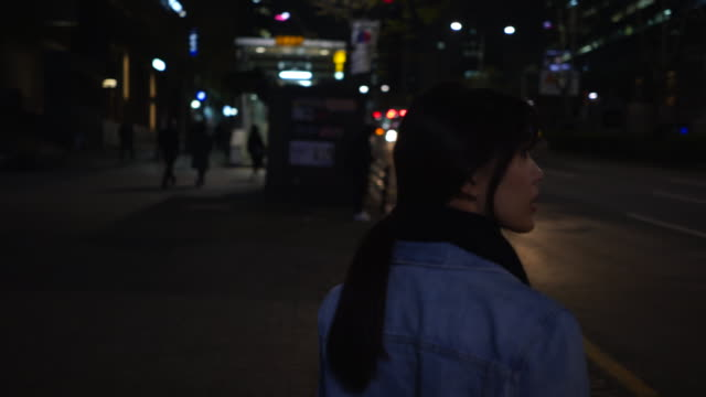 close up, woman in seoul at night - only mid adult women stock videos & royalty-free footage