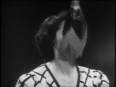 B/W 1955 close up woman juggling pins in circus