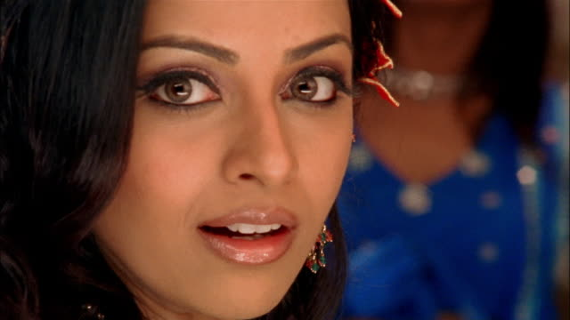 close up woman looking at camera and smiling - bollywood stock videos and b-roll footage