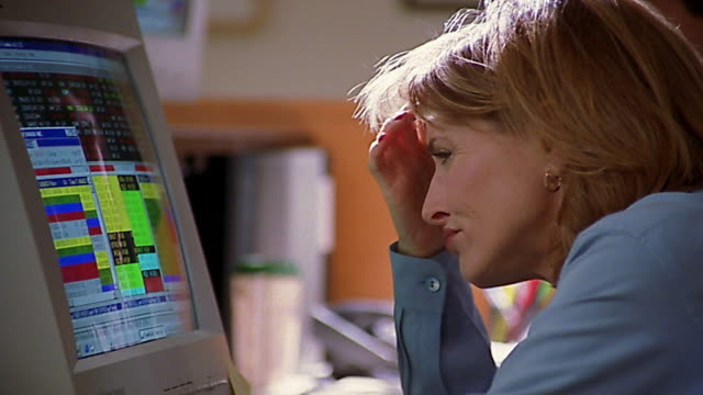 Close up woman looking frustrated in front of computer screen