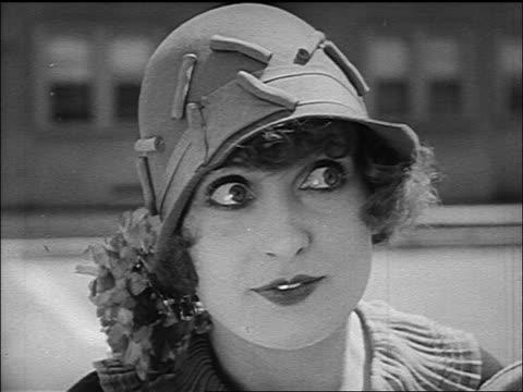 b/w 1926 close up woman (ruth hiatt) looking to side + fluttering eyelids - 1926 stock-videos und b-roll-filmmaterial