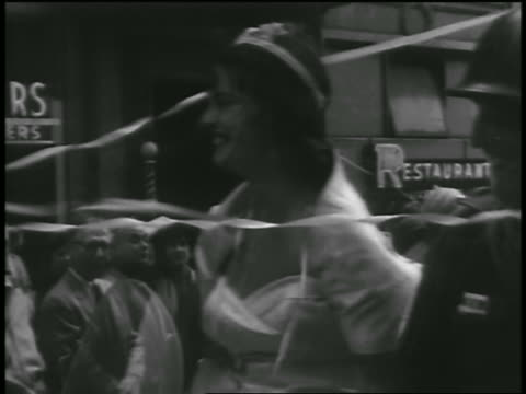 vídeos de stock e filmes b-roll de b/w 1954 close up pan woman riding with soldiers in car in parade after korean war / seattle - 1954
