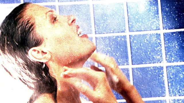 overexposed close up woman rinsing hair in shower - overexposed stock videos & royalty-free footage
