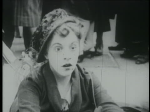 b/w 1925 close up woman (martha sleeper) sitting on curb looking surprised - 1925 stock videos & royalty-free footage