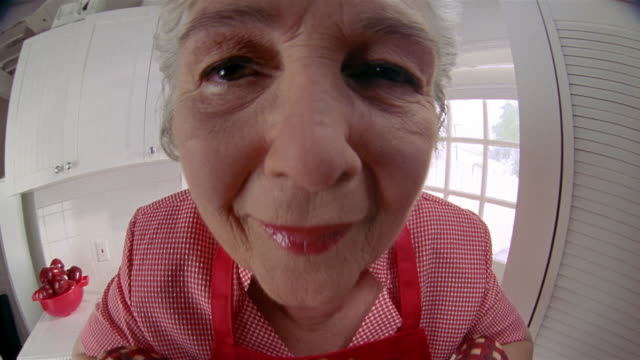 close up woman smiling at cam and holding an apple pie - wide angle stock videos & royalty-free footage