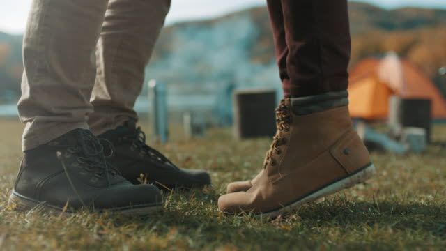 close up, woman standing on her toes beside man - love stock videos & royalty-free footage