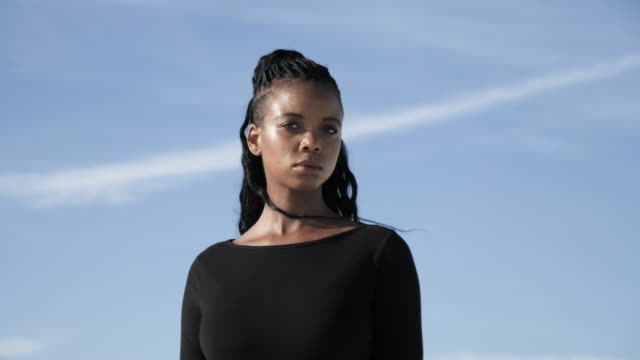 close up, woman stands in desert on clear day - black hair stock videos & royalty-free footage