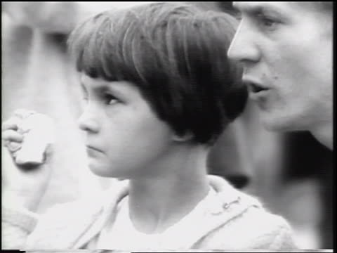 close up woman talking to crying girl outdoors / west berlin, germany / cold war / newsreel - 1961 stock videos & royalty-free footage