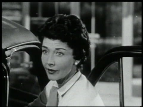 b/w 1959 close up woman unloading car looks up + smiles in recognition - 1959 stock videos & royalty-free footage