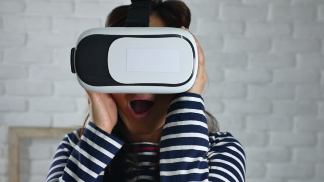 Close up Woman Uses Virtual Reality Headset at home