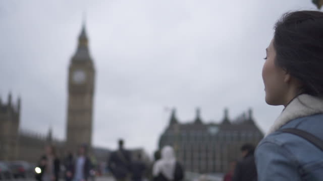 close up, woman walks on westminster bridge - big ben stock videos & royalty-free footage