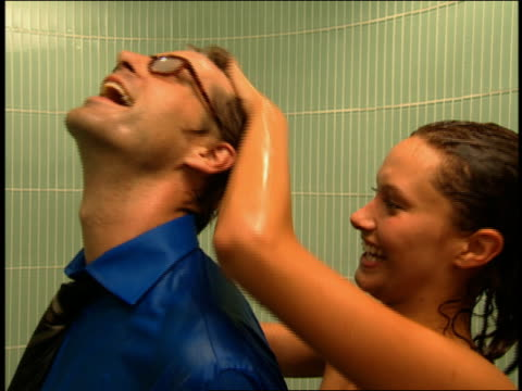 close up woman washing man's hair in shower - bar of soap stock videos and b-roll footage