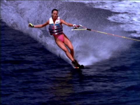 slo close up woman waterskiing on ocean in tahiti / lets go + crashes into water - waterskiing stock videos & royalty-free footage