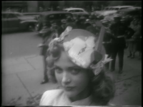 vidéos et rushes de b/w 1952 close up woman wearing i like ike record with record player needle hat outdoors / nyc - 1952