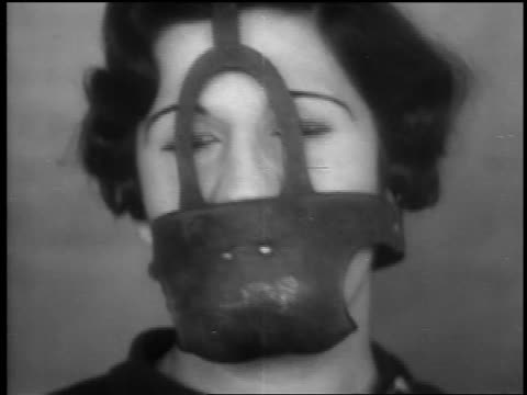 B/W 1932 close up woman wearing metal mask which covers mouth